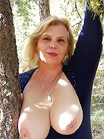 Awesome experienced female posing undressed outdoors