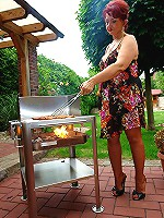 Tremendous woman on high heels making a BBQ