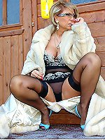 Blonde MILF in stockings and heels stripping