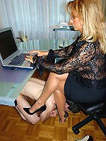 Office slave licking her delicious long legs