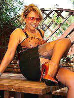 Leggy mature woman flashed her shaved puss