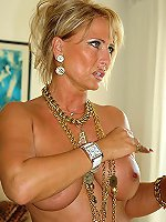Mature blonde is having the awesome big boobies