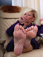 Busty woman is playing with her accurate soles
